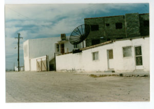Street view of a radio station in Ojinaga owned by Malaquias Flores where the author first interviewed Pablo Acosta. Flores operated a private radio communication system for Acosta from this site. A former Ojinaga police chief, Flores became a liaison officer with the Mexican army ostensibly to handle public relations, whereas in fact he served as a go-between for the Mexican army garrison commander in Ojinaga and Acosta and played an important role in the protection the military gave the Ojinaga drug lord. (Photo by the author)
